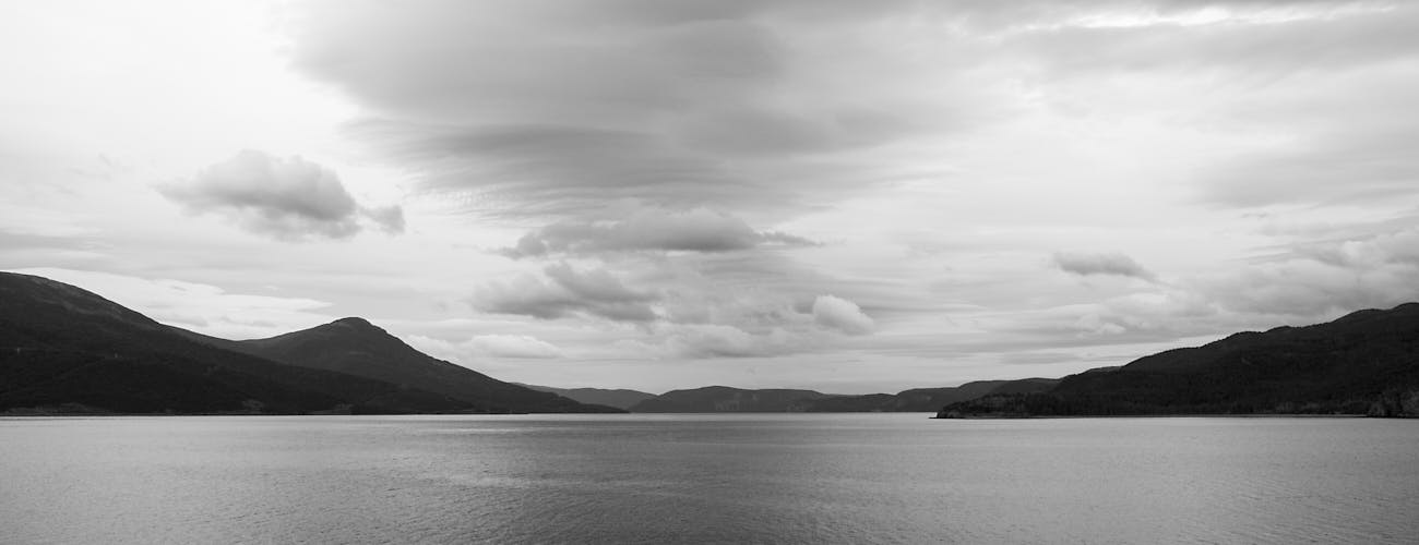 Dramatic black and white of sky and ocean.